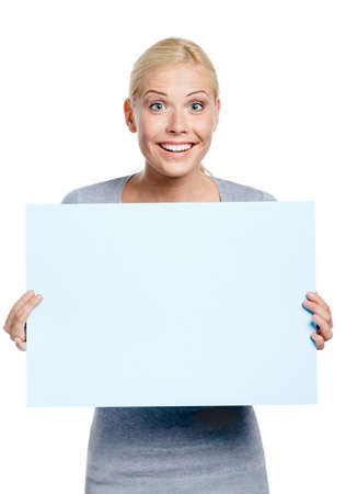 Female keeping huge sheet of white paper, isolated on white, copyspace photo