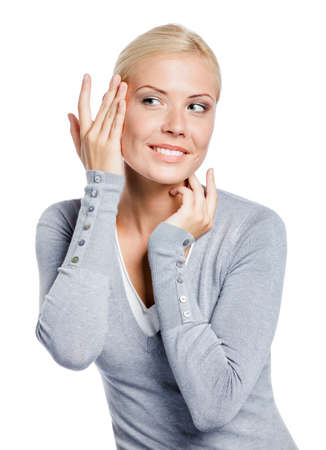 appear: Girl examining her face and wrinkles that can appear, isolated on white