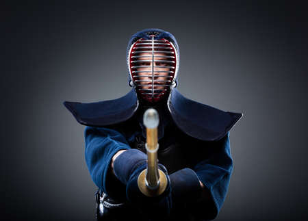 Portrait of kendo fighter with bokuto. Japanese martial art of sword fighting