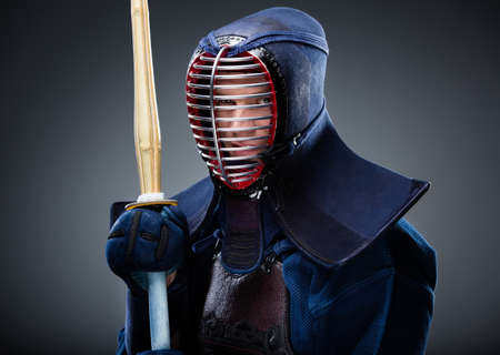 kendo: Portrait of kendo fighter with bamboo sword. Japanese martial art of sword fighting Stock Photo