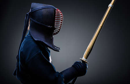 traditional weapon: Profile of kendo fighter with bokuto. Japanese martial art of sword fighting