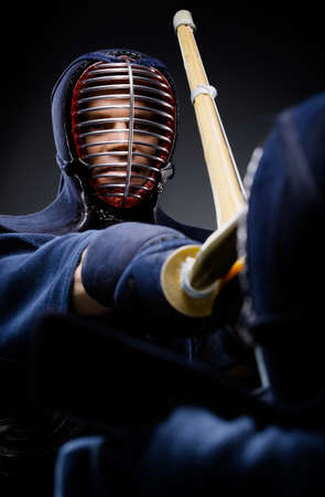 kendo: Close up of competition of two kendo fighters. Japanese martial art of sword fighting