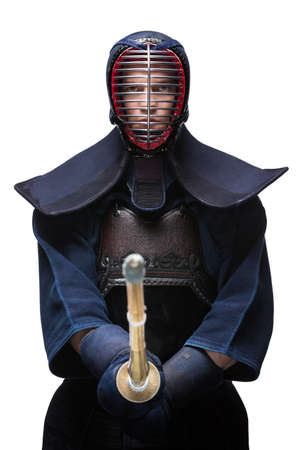 kendo: Portrait of equipped kendoka with shinai, isolated on white. Japanese martial art of sword fighting