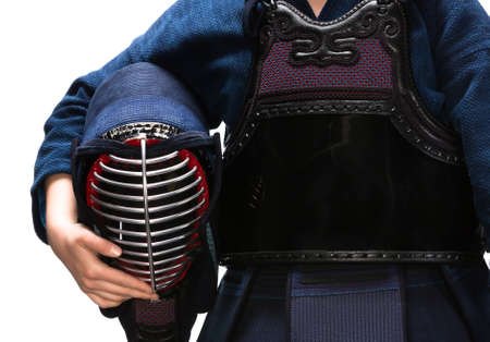 kendo: Close up of kendo men in hands of kendo fighter, isolated on white. Japanese martial art of sword fighting