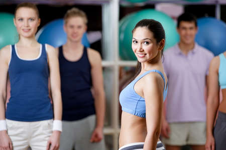 Group of people exercise at the training gym in a fitness class photo
