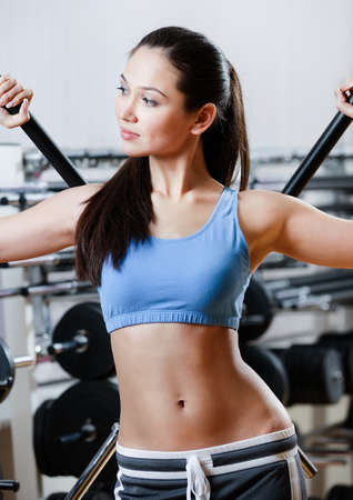 keep fit: Athletic girl with dumbbells in sport centre Stock Photo