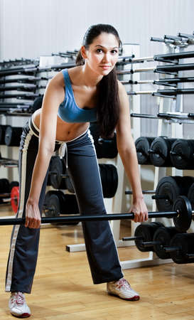 Sportswoman with dumbbells in sport centre Stock Photo - 19411493