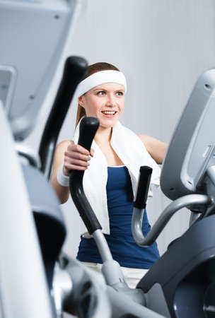 keep fit: Young athlete woman training on gym training in gym