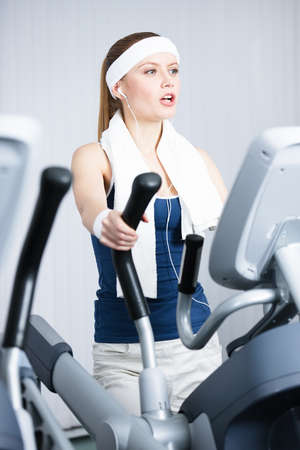 Young athletic woman training on gym training in gym photo