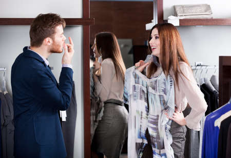 try: Man shows that the dress suits his lovely girlfriend Stock Photo