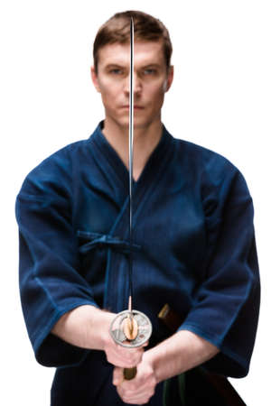Kendo fighter in hakama training with sword, isolated Stock Photo