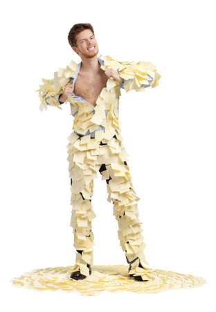 ripping shirt: A young man ripping off his shirt, covered with stickers, isolated on white background