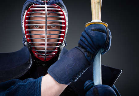 Close up of kendo fighter with shinai  Japanese martial art of sword fighting photo
