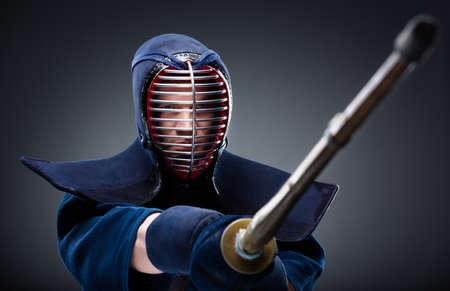 kendo: Portrait of kendoka with bamboo sword  Japanese martial art of sword fighting