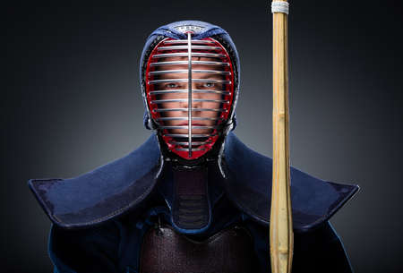 kendo: Portrait of kendoka with shinai  Asian martial arts concept