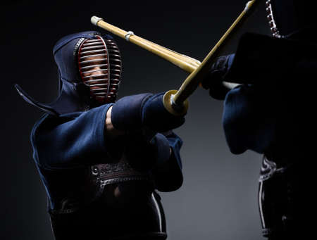 Competition of two kendo fighters  Japanese martial art of sword fighting photo