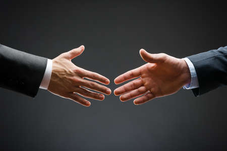forthcoming: Close up of forthcoming handshake of business people  Concept of trustworthy relations and business cooperation