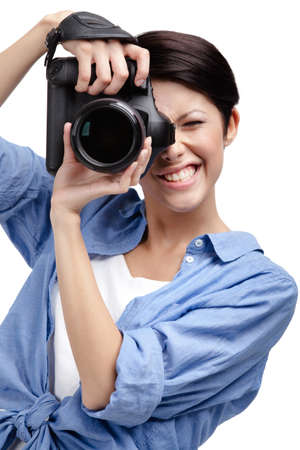 Woman-photographer takes shots, isolated on white Stock Photo - 22279100