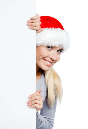 keeps: Girl in Santas hat keeps the copyspace, isolated on white