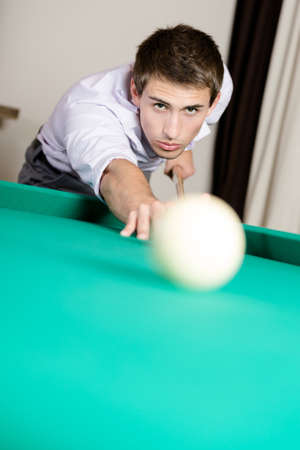 Man playing billiards. Spending free time on gambling Stock Photo - 22279437