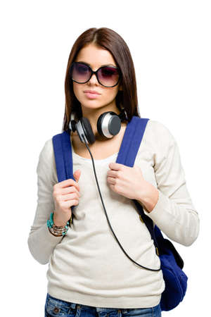 knapsack: Teenager with knapsack and earphones wearing black sunglasses, isolated on white Stock Photo