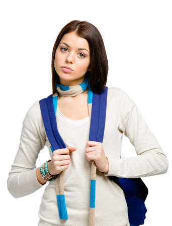 Half-length portrait of teenager wearing blue rucksack and colored scarf, isolated on white photo