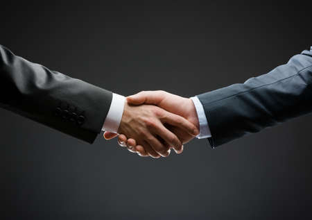 Close up of handshake of business people. Concept of trustworthy relations and business cooperation Stock Photo - 22279492