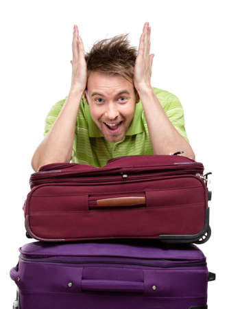 shot put: Man leaning on the pile of travel bags, isolated on white. Concept of traveling and cool vacations