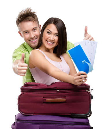 Couple with suitcases and tickets, isolated on white background. Concept of romantic vacations and lovely honeymoon photo