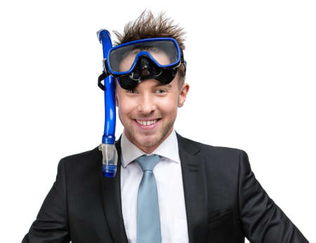 Businessman wearing suit and goggles with snorkel, isolated on white