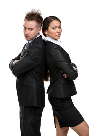 business rival: Two business people stands back to back with their arms crossed, isolated on white. Concept of competition and job competitive promotion