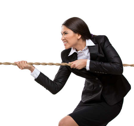 Businesswoman pulls the rope, isolated on white. Concept of competition and job competitive promotion photo