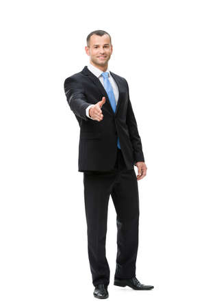 full body shot: Full-length portrait of businessman handshake gesturing, isolated on white. Concept of leadership and success