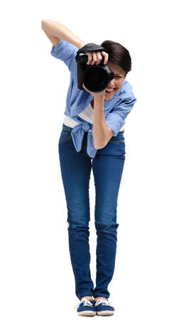 Woman-photographer takes shots, isolated on a white background photo