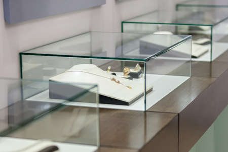 Jewelry in the showcase at jeweler's shop. Concept of wealth and luxurious life