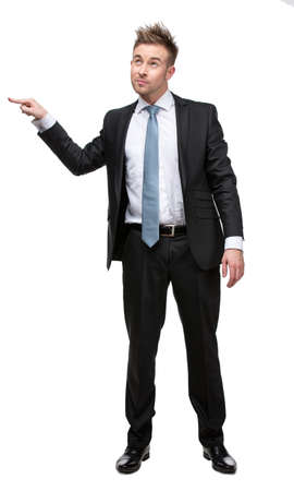 Full-length portrait of business man setting against something who wears suit with blue tie, isolated on white photo