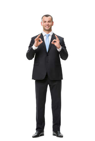 white body suit: Full-length portrait of businessman ok gesturing, isolated on white. Concept of leadership and success