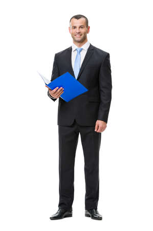 Full-length portrait of business man handing folder, isolated on white. Concept of leadership and success Stock Photo - 22529021