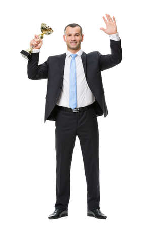 Full-length portrait of businessman with gold cup, isolated on white. Concept of leadership and success photo