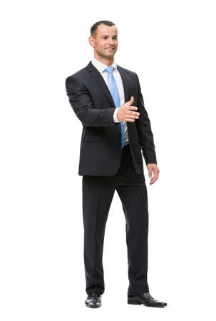 Full-length portrait of businessman handshaking, isolated on white. Concept of leadership and success photo