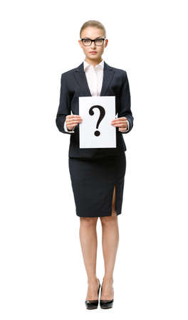 Full-length portrait of businesswoman handing question mark, isolated. Concept of problem and solution photo