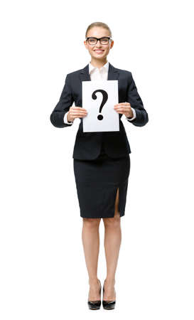 Full-length portrait of business woman handing question mark, isolated. Concept of problem and solution photo