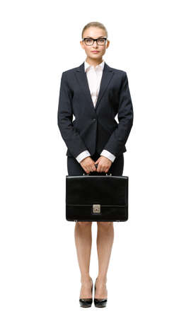 Full-length portrait of business woman handing case, isolated on white. Concept of leadership and success photo