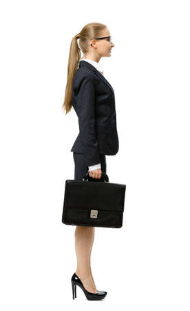 Profile of businesswoman handing suitcase, isolated on white. Concept of leadership and success photo