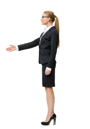 Full-length portrait of businesswoman handshake gesturing, isolated on white. Concept of leadership and success photo