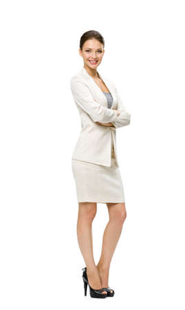 full suit: Full-length portrait of business woman with her hands crossed, isolated on white. Concept of leadership and success Stock Photo