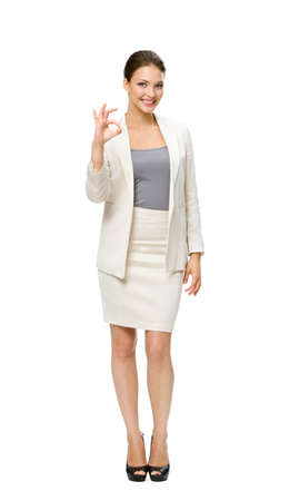 full shot: Full-length portrait of business woman okay gesturing, isolated on white. Concept of leadership and success