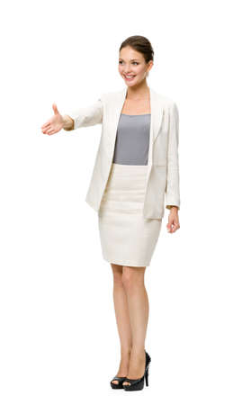 Full-length portrait of businesswoman handshaking, isolated on white. Concept of leadership and success