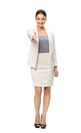 Full-length portrait of business woman handshaking, isolated on white. Concept of leadership and success photo