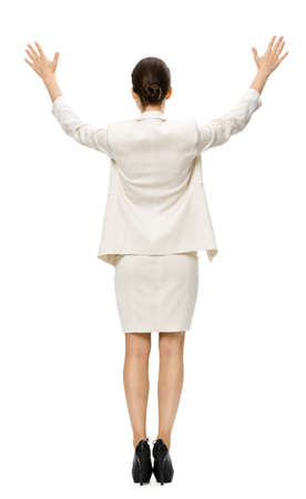 Full-length backview of businesswoman putting her hands up, isolated on white. Concept of leadership and success Stock Photo